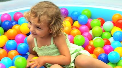 Caucasian Child Playing Ball Pool Close Up