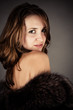 glamorous portrait of a beautiful woman in a fur coat