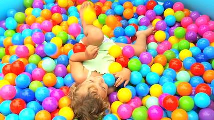 Little Caucasian Girl in Ball Pool