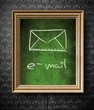 E-mail symbol chalkboard in old wooden frame