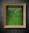 Homework with copy-space chalkboard in old wooden frame
