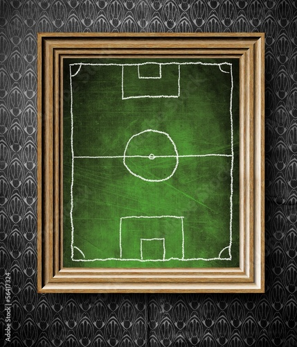 Soccer field symbol chalkboard in old wooden frame