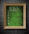 To do list with copy-space chalkboard in old wooden frame