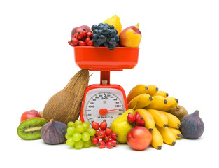 Kitchen scales and fresh fruit isolated on white background