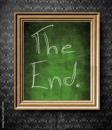 The End symbol chalkboard in old wooden frame