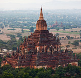 Ancient Htilominlo pagoda in Pagan archaeological zone, Myanmar poster