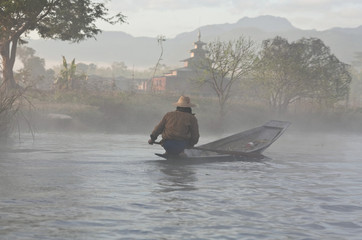 Pa-O tribe people floating in wooden boat on Inle lake, Myanmar