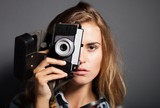 Young photographer taking pictures with old camera