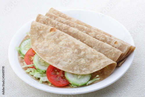 Vegetarian sandwich, chapati with fesh vegetables.