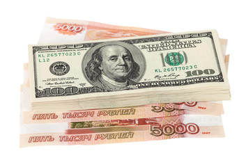 Stack of dollar bills laying over rouble background