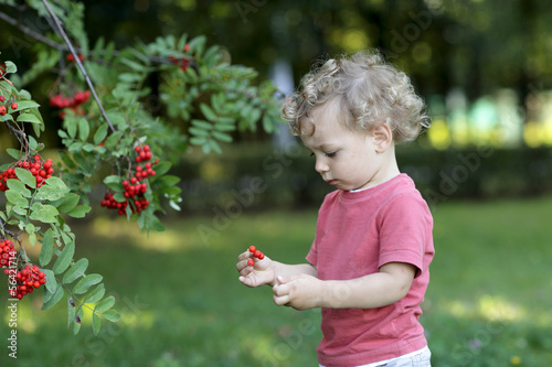 Curly child at garden