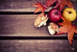 Autumn wooden background with mushrooms and apples