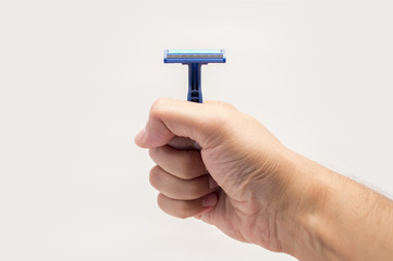 hand showing a safety razor