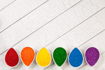 A rainbow border of colorful baking sprinkles