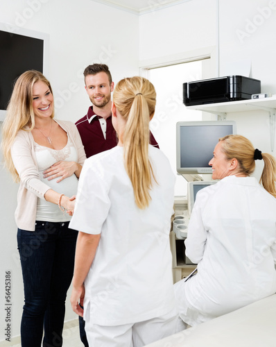 Expectant Couple Visiting Gynecologist