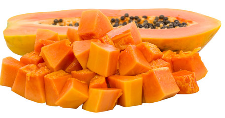 Bite size papaya fruits over white background