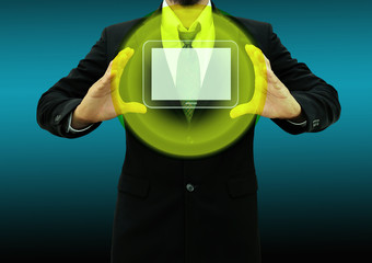 Business man holding  tablet computer in his hand