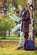 Young male student reading a book in a park