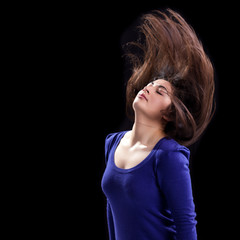 Attractive Young Woman's hair caught in Action