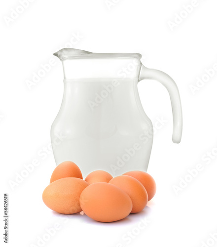 Glass jug of fresh milk and egg on white background