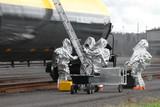 HAZMAT Team Sets Up Ladder And Equipment