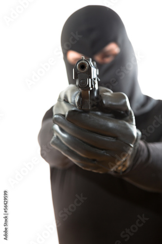 Thief pointing a gun