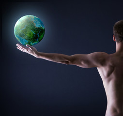 Athlete holding planet earth in his hand.
