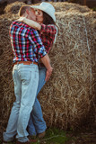 couple kissing near hay