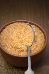 brown sugar in a bowl and spoon, selective focus, close-up