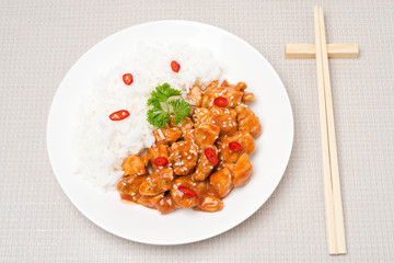 chicken fillet in tomato sauce with sesame seeds, rice, top view