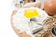 flour, eggs, rolling pin and baking forms on wooden board