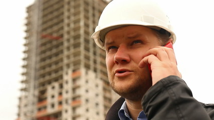 Construction engineer talking on the phone