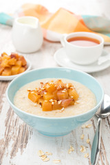 oatmeal with caramelized peaches, tea and yogurt for breakfast