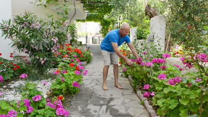 Footage of a man pruning flowers