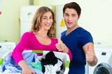 couple in a coin laundry washing