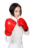 Businesswoman with red boxer gloves, white background, copyspace