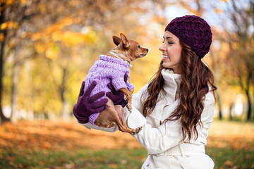 woman with her little dog in autumn