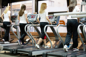 people running on machines, treadmill