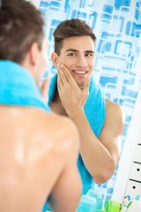 satisfied handsome man aftershave