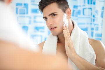 Man putting on shaving cream