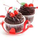 Chocolate Cupcake with cherries and cream