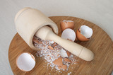 chapping eggs shell into powder of calcium poster