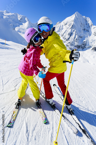 Skiing, winter - happy skiers on ski run