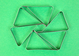 Tablecloth clamps on a green background