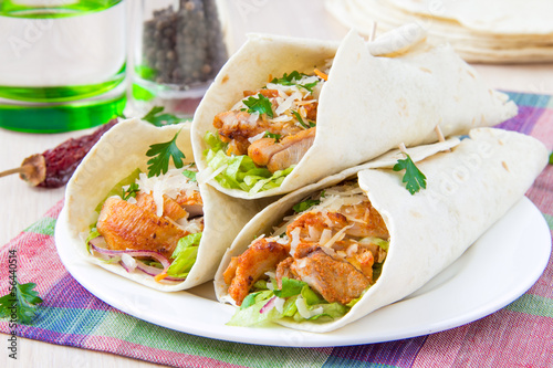 Wrapped in tortilla roll with fried chicken and vegetables