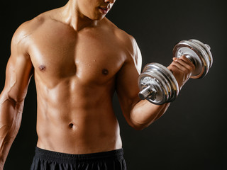 Asian male doing bicep curls