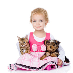 little girl hugging a kitten and a puppy. isolated on white