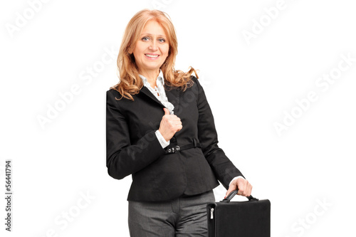 Mature businesswoman leaning against a wall