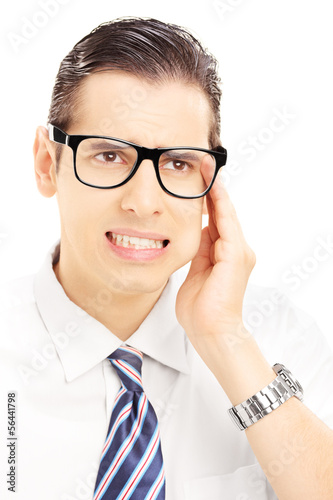 Portrait of a young man having a toothache