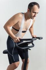 Man exercising on stationary bike